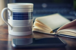Cup and notebook on table