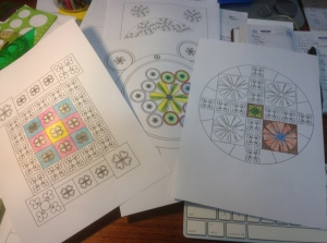 Pages with mandala designs partially colored.